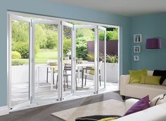 Hang bamboo shades on your Folding Glass Patio Doors for instant island style. You can hang two separate natural bamboo shades for each half of the sliding glass door, or you can buy one that fits the entire width. House Design, Door Design, House, Home, Double Sliding Doors, Bifold Doors, External Bifold Doors, Room Divider Doors