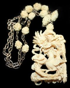 Antique ivory carved pendant necklace......