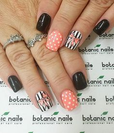 Bow inspired nail art in pink, black and white. Fill your nails in an interesting combination of stripes, polka dots, matte and bows.