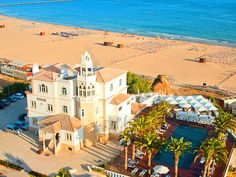 Hotel Bela Vista Portimão, Algarve, Portugal, is a fin-de-siècle seaside villa with two modern annexes in one of the Algarve's most popular resort towns. Decks have stunning views of the breakers, and giant palms shade the pool.
