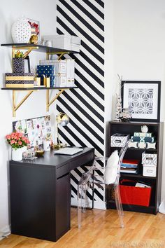 Sure, you can paint an accent wall in a different color, but what about painting a pattern? Stripes add a graphic punch and can be easily created with strategically placed painter's tape.