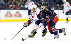 Foot race:   Washington Capitals Alex Ovechkin and Columbus Blue Jackets Cody Goloubef chase a loose puck during the third period of an NHL hockey game, Tuesday, Jan. 19 in Columbus, Ohio. The Capitals defeated the Blue Jackets 6-3.  -    © AP Photo/Jay LaPrete
