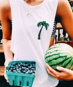 Awe I love that outfit! A swimsuit w/ tank top over it + fruit = paradise