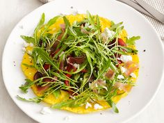 Get this all-star, easy-to-follow Open-Faced Omelet With Arugula Salad recipe from Food Network Kitchen