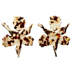 """Our best selling earring in a new color. 3"""" by 2 1/2"""" hand swirled tortoise acetate lily flower with 14k gold plated clip on backs. Lightweight and wearable from day to night. Padded clip-on closure."""