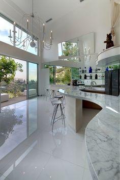 Sleek, modern kitchen with marble worktop