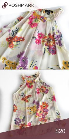 "Beautiful floral halter blouse This Rafaella floral hater blouse is white with bright flowers. Zips up the back. 100% polyester. Laying flat underarm to underarm about 18"", length about 25"" Macy's Tops Blouses"