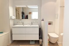 Séparation d'une grande salle de bain dans un appartement à Boulogne-Billancourt