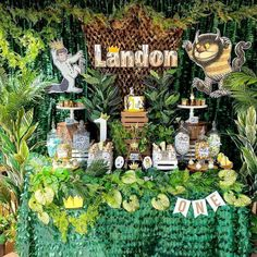 Where the wild things are wild one birthday party desser table with petal leaf tablecloth and backdrop with a mixture of ferns, ivy's, palms, and assorted greenery 1st Birthday Boy Themes, Birthday Party Treats, 1st Birthday Party Decorations, Wild One Birthday Party, Superhero Birthday Party, Boy First Birthday, Boy Birthday Parties, Wild Ones, Wild Things