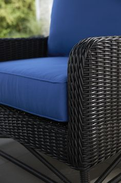 Inspired by the grand natural surroundings of classic mountain lodges, this timeless outdoor chair features fresh bold contours and clean architectural lines. Designed exclusively for Crate and Barrel by Royce Nelson, this updated wingback lounge chair makes a timeless statement in rich deep black recyclable resin wicker.
