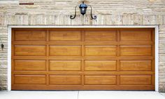 #Doortec #Garage Doors custom gel stained wood door, this will set a #trend in any neighborhood, and will keep its value for many years to come. We offer same service with the highest quality products. Call us today at 405-720-7107 or visit us at http://www.doortec.com to receive a one time only 50th anniversary special.