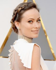 Seen at: 2016 Academy Awards    Wilde wore her hair in a delicate braid twisted into a low bun, which added some romance to her sexy Valentino gown, with its plunging neckline and open back.