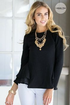 Street Style // Create a street rock chic look with this black peplum ruffled top.
