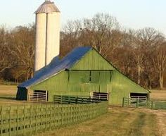 Green barn with large silo