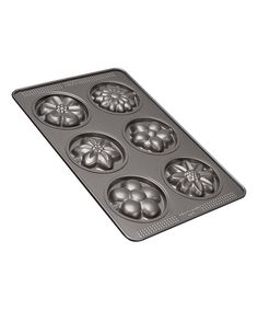 Sweet Creations Flower Cookie Pop Pan | zulily  . $11.99 $16.00 Product Description:  Bake delicious floral cookies or candies using this pop pan's flower-shaped molds.      9.5'' x 14.75''; 0.5'' deep     Carbon steel     Nonstick     Hand wash     Imported