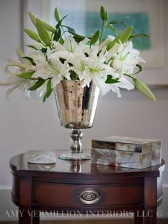 Beautiful Casa Blanca Lilies in a stunning vase.