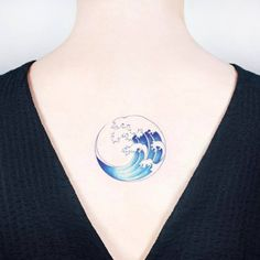 Wave circle tattoo on the upper back. Tattoo Artist: Ida