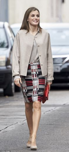 Queen Letizia, 45, looked chic in a red, black, white and beige graphic pencil skirt and b...