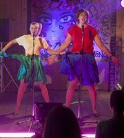 Miranda and Stevie do Bucks Fizz at the karaoke night.