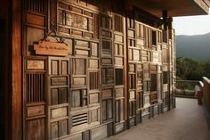 Wall of vintage cabinet parts at Six Senses Resort in Con Dao, Vietnam designed by AW²