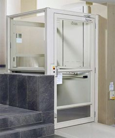 AcessNSM's V-1504 vertical platform lift/wheelchair elevator is most commonly installed in commercial settings, although it is frequently used for private residences. Elegant design options allow this wheelchair elevator to fit into any public building, acting as a lift for wheelchair access to multiple levels, carrying both a wheelchair user and passenger.