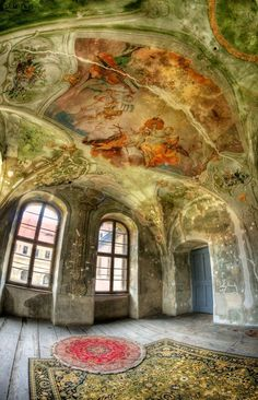 Stunning art work and architecture in this abandoned castle in Poland.