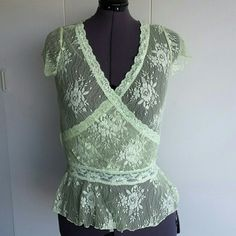 Green lace peplum top XL Green lace trimming, around neck waist  . 100% nylon and stretchy  . Made in USA  Label states 3xl . XL is better fit Mine Tops Blouses