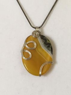 Beautiful Polished Slice of Wire Wrapped Yellow Lace Agate On a Grey Snake Chain by GlowDaily on Etsy