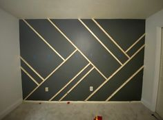 Give your wall some dramatic character with this easy to-do accent wall! Paint the wall I started by painting the wall and the baseboard with the color in… Diy Wand, Painters Tape Design, Geometric Wall Paint, Modern Wall Paint, Modern Wall Paneling, Panelling, Best Wall Paint, Installing Wainscoting, Accent Wall Bedroom
