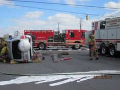 """The """"tie-back"""" operation is a commonplace method of securing an overturned vehicle. The methods uses some basic laws of physics to provide stability. So for our non-FD friends - this is just one more example of how math and science helps you in your adult life. Much of heavy rescue work is about understanding physics and the laws of gravity and force."""