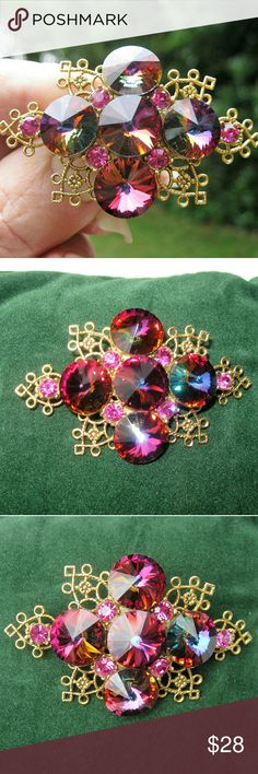 VINTAGE  Fashion Fuchsia Rivoli Crystal Brooch Elegant vintage brooch in shades of fuchsia.  Five (5) foil backed fuchsia rivoli crystals and six (6) fuchsia chaton crystal rhinestones are hand set in a scroll work gold tone setting.  Secure roll over clasp.  No dull, chipped, replaced or missing stones.  EUC  An eye catching example of jewelry art! (617NN-73) VINTAGE Jewelry Brooches