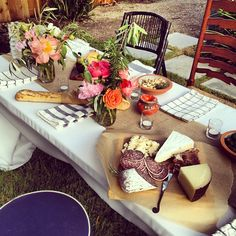 mismatched chairs, wine, cheese, pretty flowers....bliss