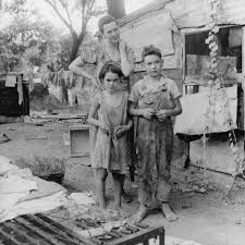 This is a picture taken during the Great Depression. A mother stands with her two children wearing old, ripped up clothing. The area surrounding them is dirty and resembles a waste yard. This is a credible source because it is picture taken at the time of the Great Depression. This picture shows how all Canadians were forced to live. Money was scarce, and people could not afford clothes. Therefore, people had to change their lifestyle according to how much money they had.
