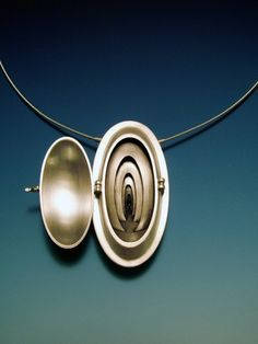 """Passage II 2006 sterling silver, 18k yellow gold. 2.25"""" x 1.5"""" x .75""""  Fabricated, die formed. Private Collection."""