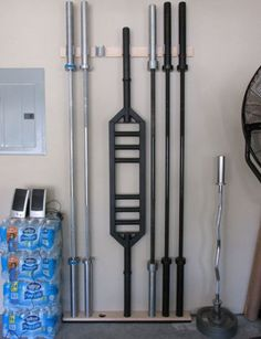 DIY Barbell Storage Rack in the Garage Gyms' garage gym https://uk.pinterest.com/uksportoutdoors/home-gyms/pins/