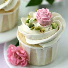 Rose Water Cupcakes with White Chocolate Swiss Meringue Buttercream topped with pistachios and gumpaste roses.