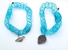 The components i like from these bracelets are the flat metal charm. If i were to make a design like this for the project, i would make it all into one bracelet, and change the blue part to metal so that it would fit the requirements.