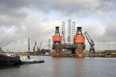 Ingimage | Stock Image Details: ISS_5452_01661 - The dismantling of an oil rig at a dry dock in the midst of a busy commercial harbor Oil Rig, Rigs, Royalty Free Images, New York Skyline, Commercial, Stock Photos, Business, Illustration, Travel