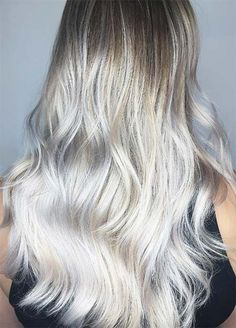 Champagne Silver Wavy Hair Champagne and silver hued hair colors create a modern look in soft waves that have a lot depth and a shine.