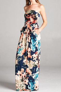 The Show Me Off Strapless Watercolor Maxi Dress - Navy the beautiful colors and florals of the changing of the seasons are on full display in this dress! Multi-colored floral print, strapless maxi dress with pockets. This dress features a ruched bust and an empire waist. Stunning dress for so many occasions. Pair with a jacket and it's perfect for the office. Pair with some cute wedges and you have the perfect party and shower dress, special event, vacation dress or date night dress!