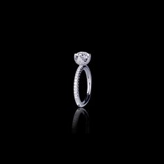 Canturi Renaissance Tulip diamond engagement with a round brilliant cut diamond (shown) or a variety of diamond shapes and sizes. In 18ct wh...