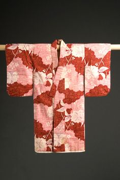 Child's kimono with sakura and wave design. Hasami-nashi kimono sewn in 1927 by Kaku Kumasaku, a picture bride who came to Hawai'i from Fukushima, Japan in 1921. Gift of Barbara Kawakami, Japanese American National Museum (2004.1.205A)