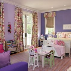 Curtains over patio doors and valances and roman blinds over our bay window maybe?