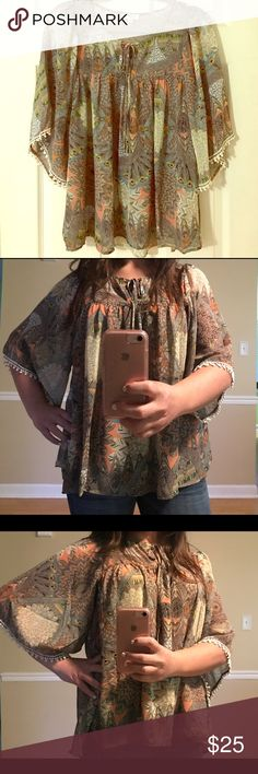 Size Medium multi print flowing top Size Medium multi print flowing top. This top is so nice and breathable. Sheer like material but you do not have to wear tank underneath (I am not wearing one in pics). Cute detailing on sleeves makes this top a must have! Tops Blouses