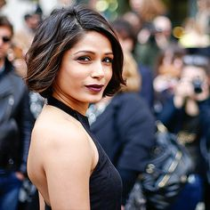Star Tracks: Monday, March 2, 2015 | STARE DOWN | Freida Pinto steals the spotlight as she arrives for Sunday's Salvatore Ferragamo show in Milan.