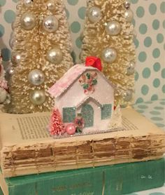 A personal favorite from my Etsy shop https://www.etsy.com/listing/556317935/putz-house-christmas-village-ornament