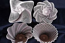 Baltic by Design handcrafted wooden bowls. Each layer is laser cut then hand glued into these unique shapes. Great conversation piece!