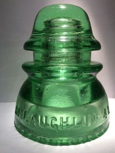 This is my McLaughlin 42 cd 154 glass insulator in apple green.