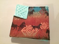 Handmade western horse baby blanket. Navajo print baby blanket. Teal minky baby bedding. Cowboy or Cowgirl nursery bedding. Great baby shower gift.   https://www.etsy.com/ca/listing/387584288/western-baby-blanket-horse-baby-blanket