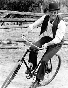 Paul Newman in character as bicycle-riding rogue Butch Cassidy